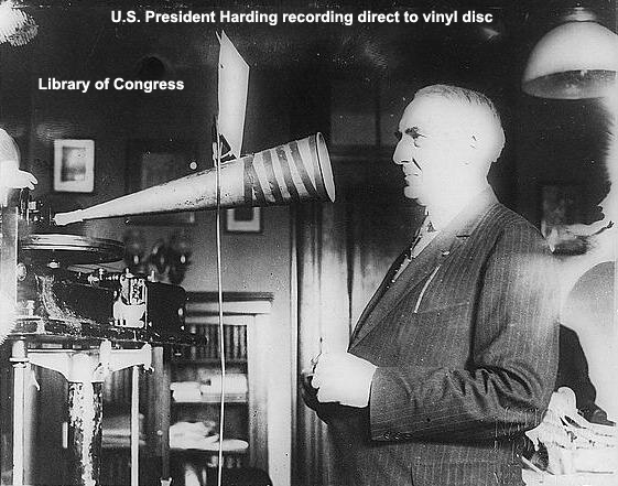 US President Harding recording into recording horn
